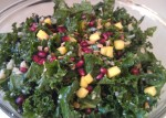 raw kale salad with pomegranate seeds and black beans